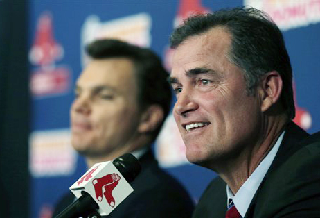 New Boston Red Sox manager John Farrell, right, smiles as he sits with general manager Ben Cherrington during a news conference at Fenway Park in Boston on Tuesday.