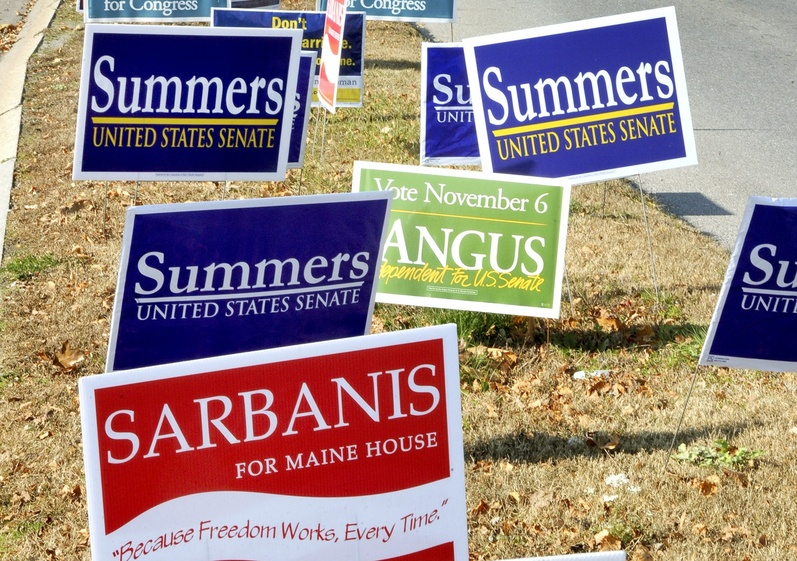 Political signs line a median last week in South Portland.