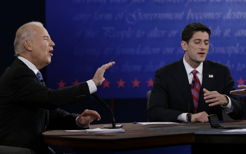 Vice President Joe Biden, left, and Republican vice presidential nominee Rep. Paul Ryan, of Wisconsin, respond to moderator Martha Raddatz during the vice presidential debate at Centre College, Thursday, Oct. 11, 2012, in Danville, Ky. (AP Photo/Eric Gay)