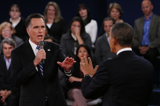 Republican presidential nominee Mitt Romney, left, addresses President Barack Obama Tuesday during the second presidential debate at Hofstra University in Hempstead, N.Y.