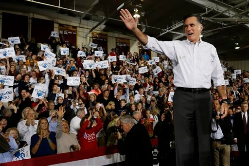 Republican presidential candidate, former Massachusetts Gov. Mitt Romney waves to supporters as he takes the stage at a campaign stop at Avon Lake High School in Avon Lake, Ohio, on Monday.