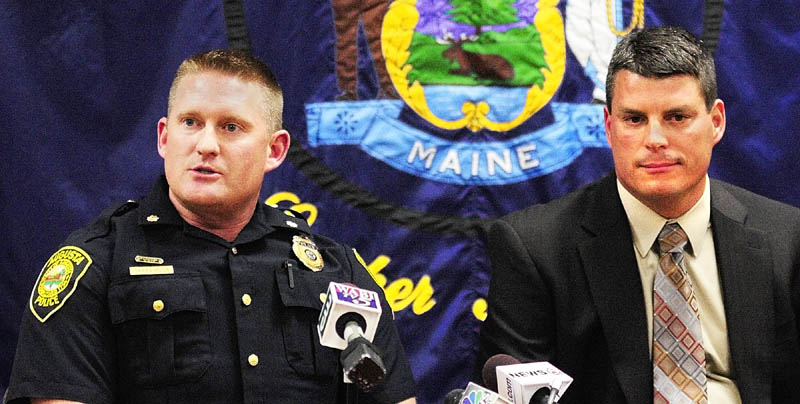 Augusta Deputy Police Chief Jared Mills, left, and state police Lt. Chris Coleman answer questions on Tuesday afternoon in Augusta about the arrest in Seattle of Gary Raub, 63, who allegedly stabbed a 70-year-old Augusta woman to death in 1976.