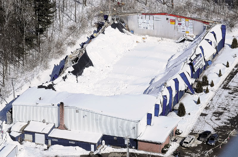 This aerial photo taken March 3, 2011, shows the collapsed roof of the Kennebec Ice Arena in Hallowell. No one was injured when the roof fell onto the rink.