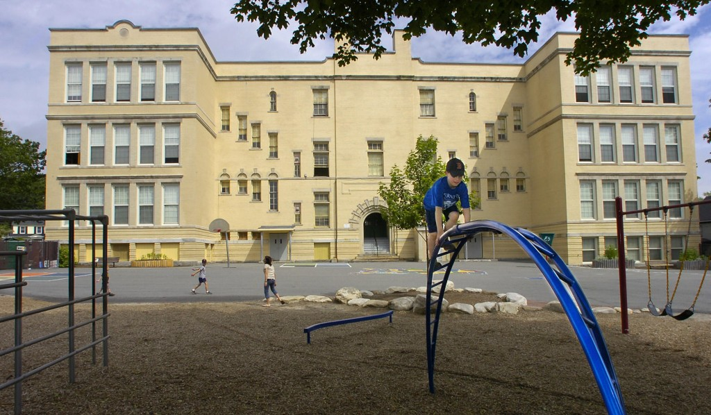 Children enjoy the playground in back of Nathan Clifford School on Falmouth Street in Portland in this 2010 photo.