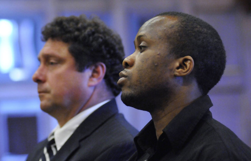 Daudoit Butsitsi listens to the judge as he is found guilty in the shooting death of Serge Mulongo on July, 21, 2011. To his left is Butsitsi's court-appointed lawyer Anthony Sineni.