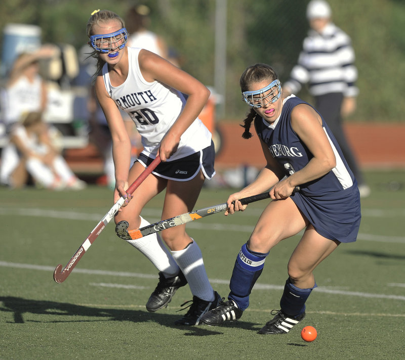 Fryeburg Academy's Christina DiPietro, right, shown in a field hockey game at Yarmouth High, excels at the sport despite being legally blind.