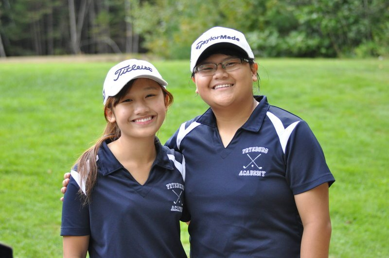 Van L. Nguyen, left, and her younger sister, Van B. Nguyen, will represent Fryeburg Academy at the state golf tournament.