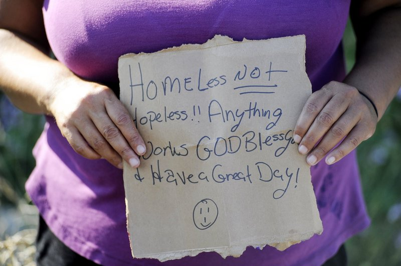 A woman panhandling on a Portland median strip expresses her hopes for a better life. A reader who gives to panhandlers asks for compassion for them.