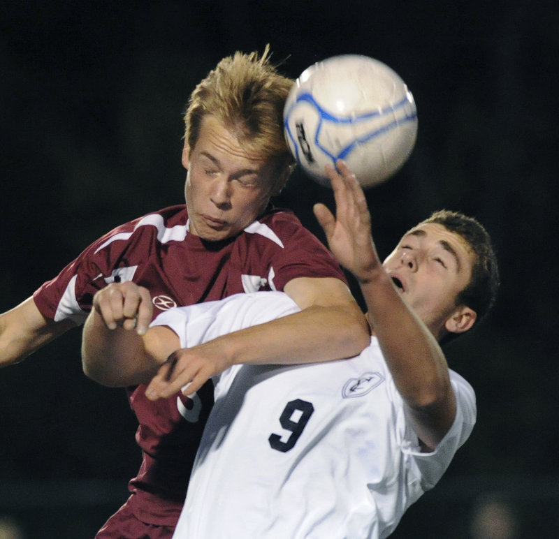 Mitchel Donovan, left, of Greely contends with Max Watson of Yarmouth for the ball during Greely's 2-0 victory Thursday night at Yarmouth.