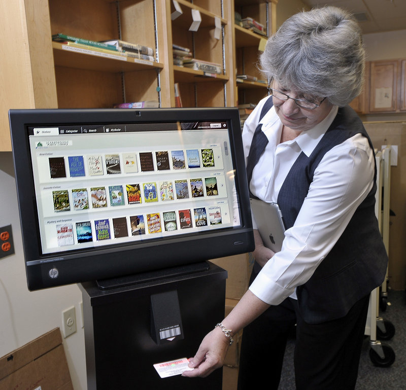 Susan Winch, assistant director of the Scarborough Public Library, demonstrates the Discovery Terminal that patrons will use to order e-books using a special, coded library card.