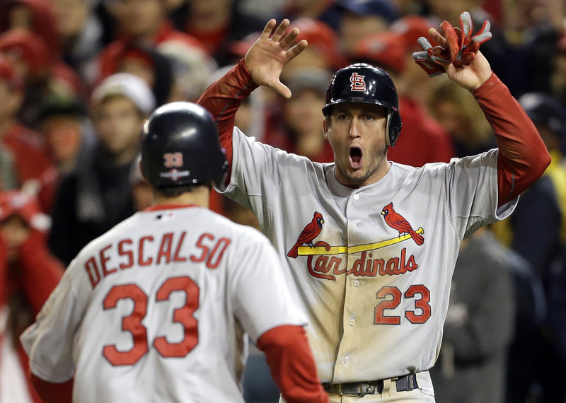 The Cardinals' David Freese is clearly pumped up as he scores on a single by Pete Kozma in the ninth inning Friday. St. Louis rallied with four runs to stun the Nationals and advance to the NLCS.