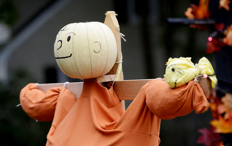 The Scifres family shows off a Charlie Brown scarecrow at their Cape Elizabeth home.