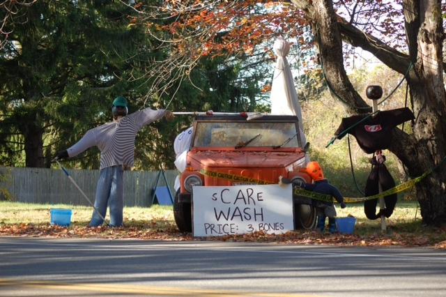 "At one Cape Elizabeth home, the cost of a ""Scare Wash"" is ""3 Bones."" Several towns around southern Maine have been holding scarecrow contests."