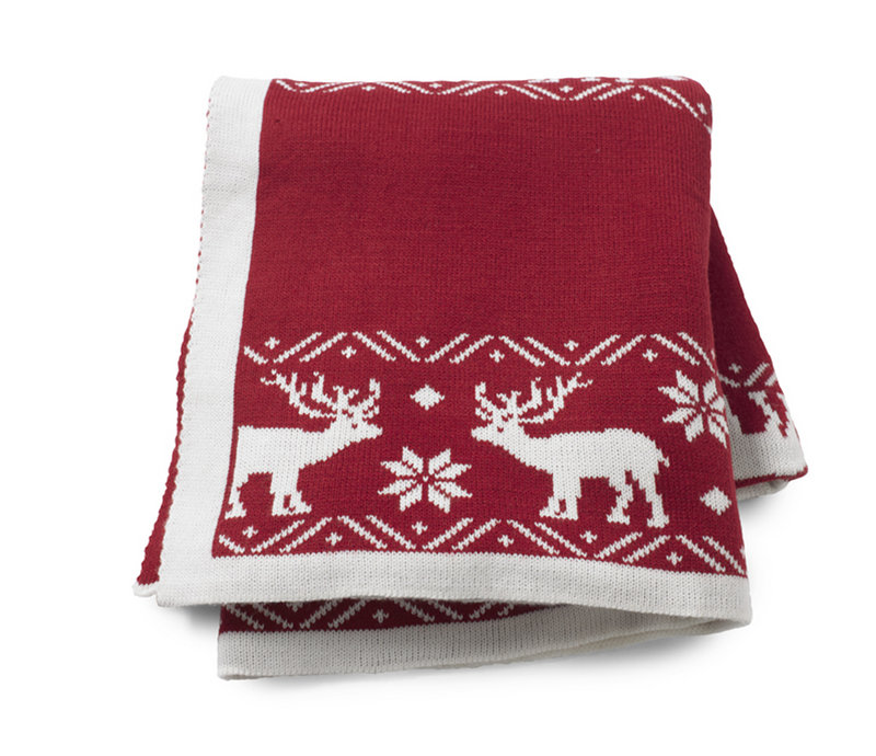 Reindeer and snowflakes adorn a throw from HomeGoods.com.