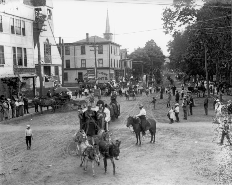 A circus parade makes its way down Main Street in Sanford around 1900. Buildings, from left, are the Brown Block built in 1896; the First Baptist Church; Nowell & Libby, now Shaw's Hardware; and the Prescott Emery store.