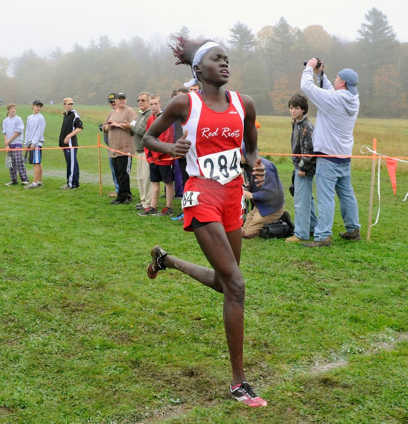 Nyajock Pan of South Portland heads for the finish line to win the Class A girls' race with a time of 19:52.15.