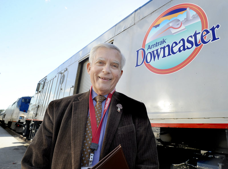 Wayne Davis stands in front of the Amtrak Downeaster at the Portland Transportation Center this month.