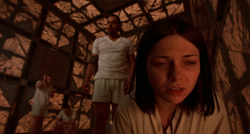 """Cube,"" a 1997 release out of Canada, finds seven strangers held captive in seven identical cube-shaped rooms, some of which are diabolically booby-trapped."
