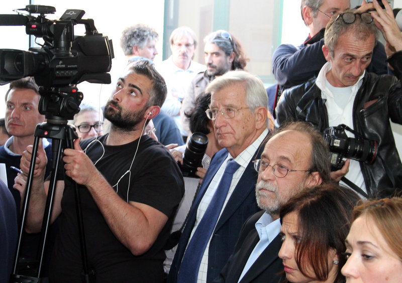 Defendants Claudio Eva, center, and Bernardo De Bernardinis, third from right, listen Monday as the verdict is read in an Italian court in a case that centered on expert statements made before a 2009 earthquake that killed 308 people.