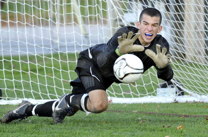 Chip Weber makes a diving save Monday during Portland's Western Class A boys' soccer prelim against Windham. The 10th-ranked Bulldogs won in double overtime, 2-1, and advanced to the quarterfinals against No. 2 Scarborough.