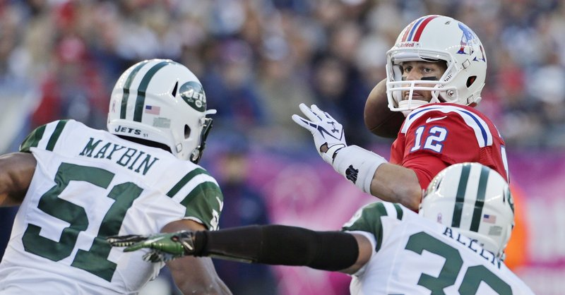 Tom Brady (12) got the Patriots' offense going on the last two drives Sunday to beat the New York Jets in overtime.