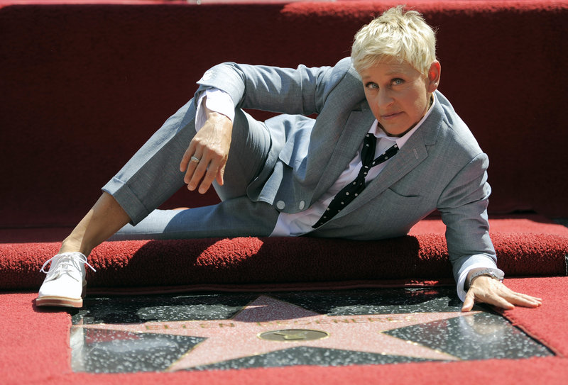 Talk show host and comedian Ellen DeGeneres poses atop her star on the Hollywood Walk of Fame. The Kennedy Center in Washington is awarding DeGeneres the Mark Twain Prize for American Humor.