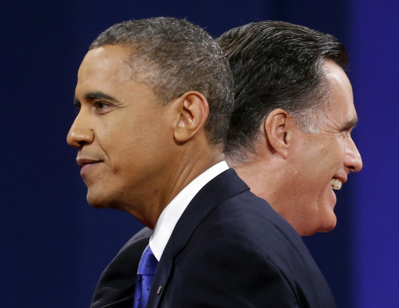 President Obama and Republican presidential nominee Mitt Romney walk past each other at the end of the third presidential debate in Boca Raton, Fla., on Monday.