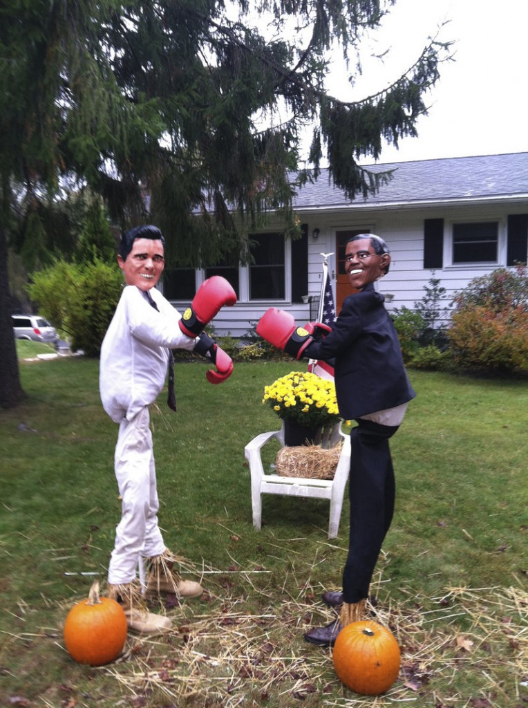 Michele Tobey of Cape Elizabeth uses Obama and Romney masks on these scarecrows, which she's entered in a local contest. She often finds cars stopped in the street with passengers taking pictures of the figures.