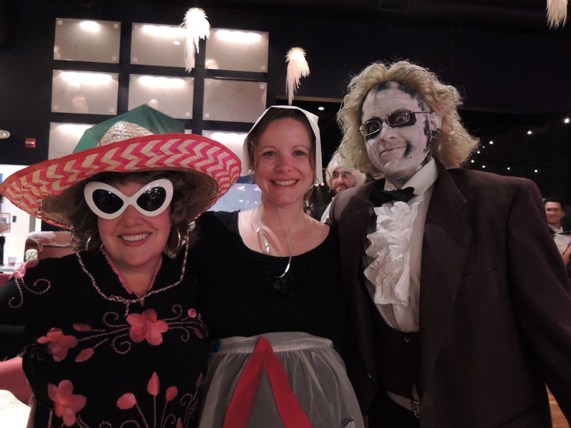 "Goodwill employees Kimberly Curry of Portland, as a tourist from Mexico; Michelle Smith of Portland, as Hester Prynne from ""The Scarlet Letter""; and Manny Archibald of Gray, as Beetlejuice"