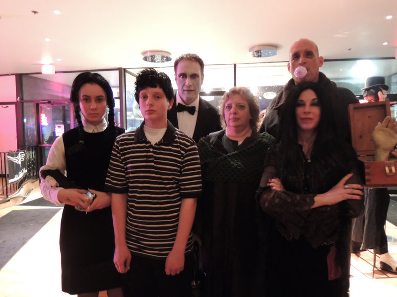 The award for Most Creative Use of Goodwill Finds went to the Addams Family: Helena, Hunter and Matthew Arbo of Cumberland (as Wednesday, Pugsley and Lurch); Peggy and Rich Williams of Richmond (as Grandmama and Uncle Fester); and Amy Harren of Greenwood (as Morticia). Even The Thing was present ... as The Thing.