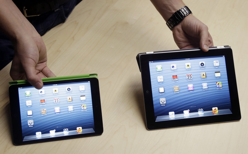 The iPad Mini, at left, is shown next to the 4th Generation iPad in San Jose, Calif., on Tuesday.