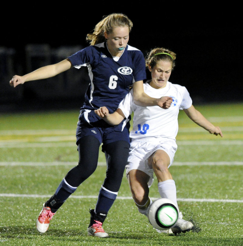 Falmouth's Cassie Darrow, right, gets in front of Yarmouth's Ariel Potter to control the ball during the Yachtsmen's 2-0 Class B quarterfinal win at Falmouth on Tuesday.