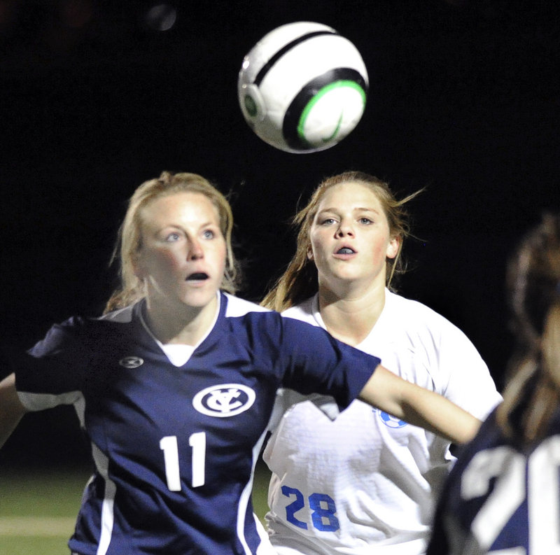 Yarmouth's Alexa Sullivan, left, battles for position against Falmouth's Laura Baer in Falmouth's 2-0 win Tuesday. Yarmouth ends its season with a 5-7-4 record.