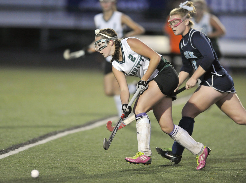 Bri DeGone, who scored the only goal of the game, drives the ball into the York zone ahead of Tori Stocks during Leavitt's 1-0 victory. Leavitt will meet Belfast for the state title Saturday at Orono.