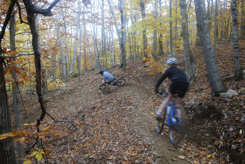 Members of the Camden Hills High mountain bike team train at the Camden Snow Bowl on Oct. 23. The month-old, 2,500-foot-long downhill course cost nearly $8,000 with the use of volunteer labor.
