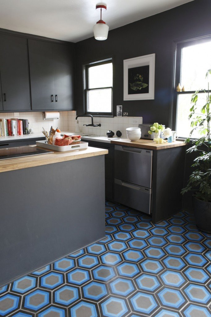 Hexagon #8 tile in shades of blue and gray in a kitchen floor by Kismet Tile