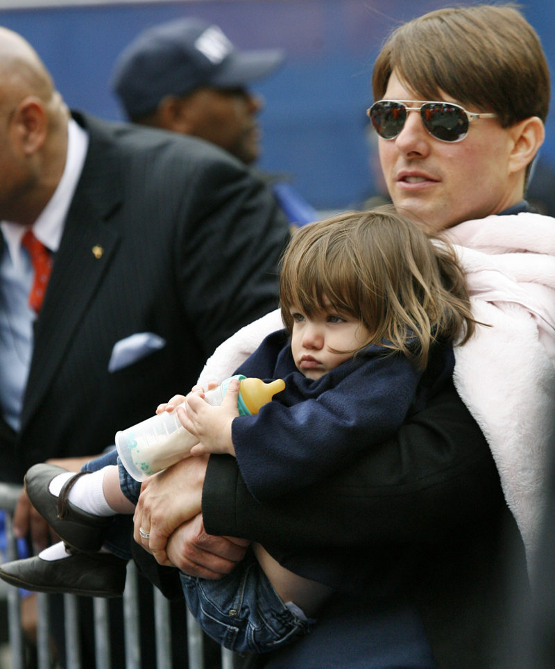 """Actor Tom Cruise holds his daughter Suri. The actor is suing Life & Style magazine for articles that said Cruise abandoned his 6-year-old daughter. Cruise called the claim a """"vicious lie."""""""