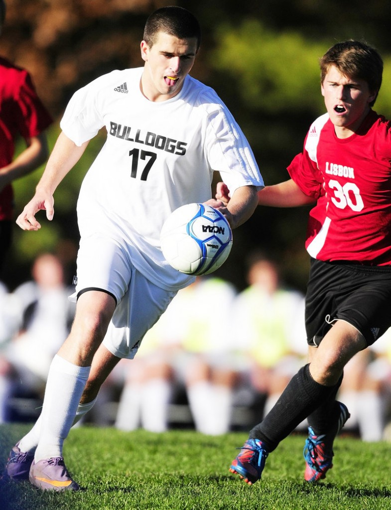 Zach Plummer of Hall-Dale, left, and Cam Ramich of Lisbon go for the ball during Hall-Dale's 7-0 victory at Farmingdale.