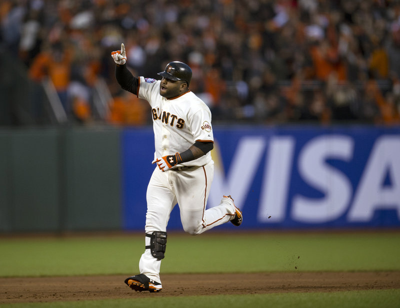 Pablo Sandoval of the San Francisco Giants rounds the bases Wednesday night after hitting the second of his three home runs against the Detroit Tigers in Game 1 of the World Series.