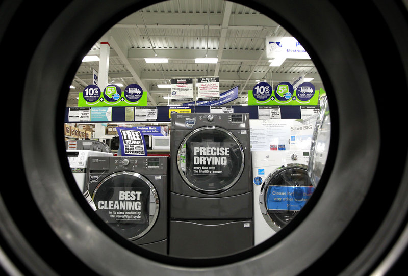 Lackluster sales of durable goods, like these laundry units at a Lowe's store, contribute to what analysts say is an overall lack of confidence on the part of U.S. businesses.