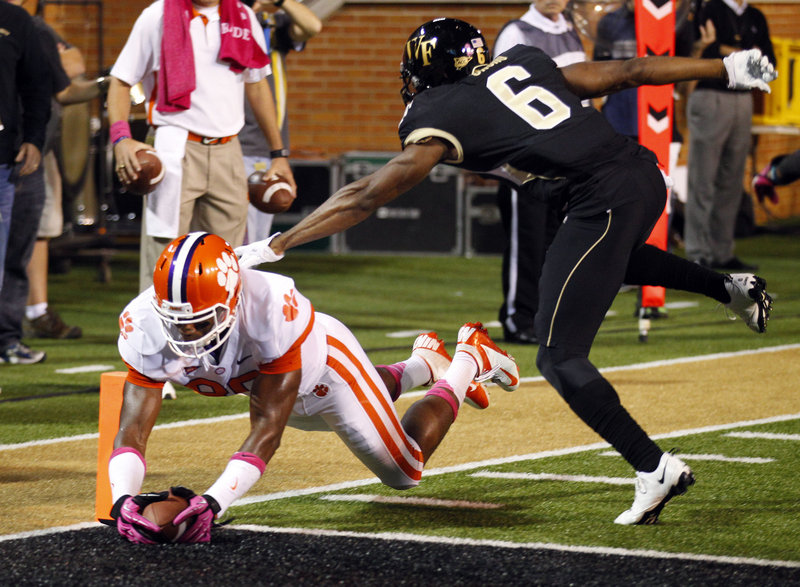 Clemson's Brandon Ford dives into the end zone for a touchdown as Wake Forest's Chibuikem Okoro defends during the first half at Winston-Salem, N.C. on Thursday night.