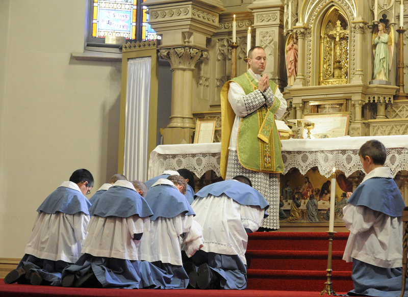 "The Rev. Canon Andreas Hellmann prays during a Latin Mass at a church in Manitowoc, Wis. In 2007 Pope Benedict XVI called it a ""precious treasure to be preserved."""
