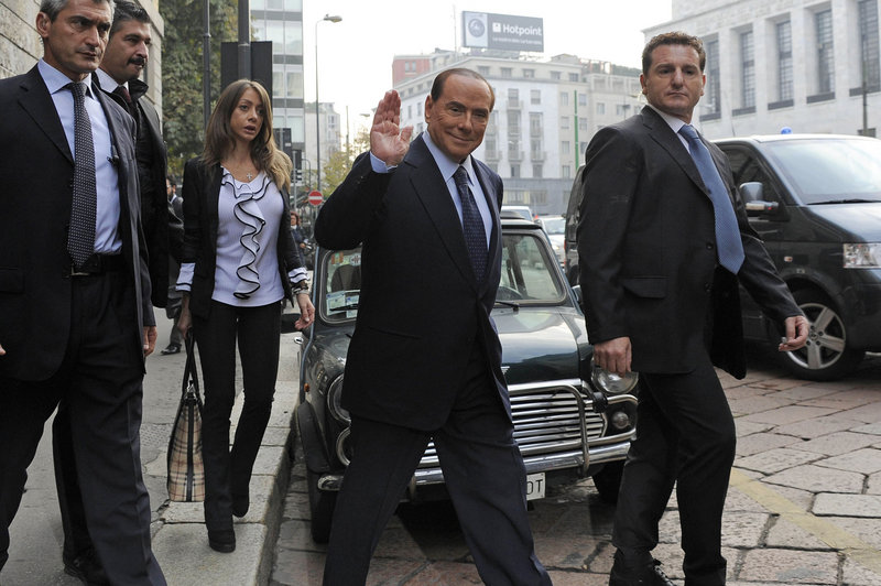 Italian Premier Silvio Berlusconi salutes as he arrives for a court hearing in Milan last week. On Friday, he was convicted of tax fraud but remains free while appeals are exhausted.