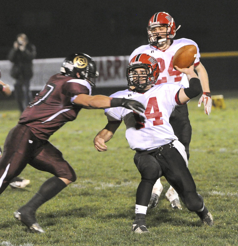 Wells quarterback Gavin Snapp attempts to get off a pass Friday night while pressured by Svenn Jacobson of Greely. Wells will take on top-ranked Marshwood in the semifinals.