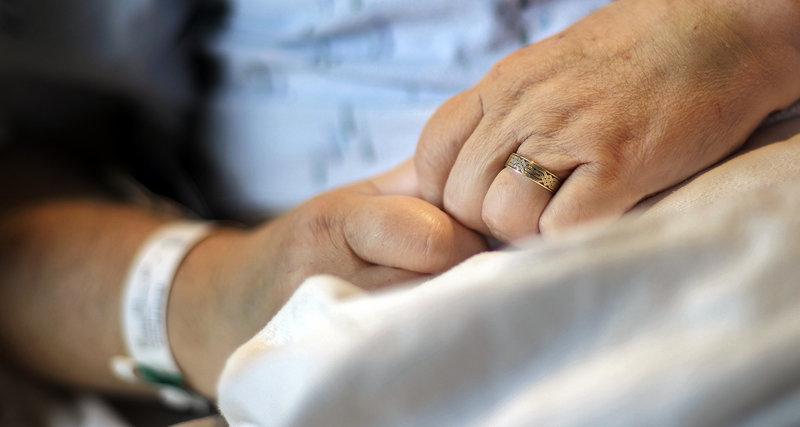 Joseph Stackpole wears his wedding band while in his hospital bed at Maine Medical Center on Friday.