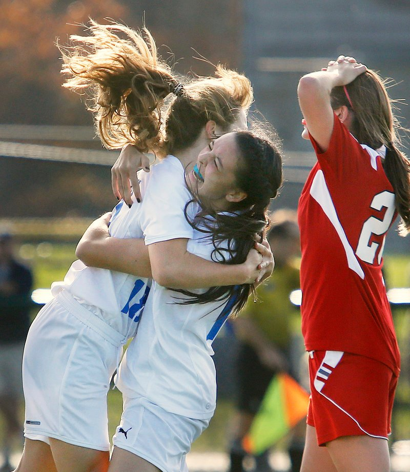 Cassie Darrow, left, gets a congratulatory hug from Falmouth teammate Megan Miller after scoring the second of her two goals in Saturday's 2-1 Western Class B semifinal victory over Gray-New Gloucester.