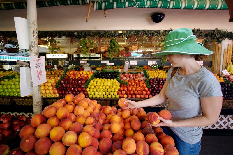 Tara Igoe shops for peaches at a fresh produce stand in Los Angeles. The U.S. Food and Drug Administration says genetically modified foods are safe to eat and don't need labels, but California voters have a chance to challenge that on Nov. 6.