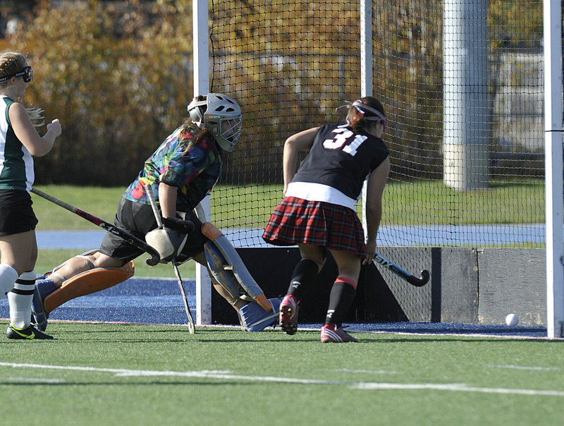 Arianna Kahler, 31, of Lisbon follows her goal as Winthrop goalie Alyssa Arsenault reacts too late in the first half of the Class C State Championship game at Orono.