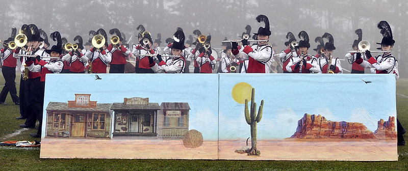 The South Portland Marching Band uses a Western theme in its performance in Old Orchard Beach on Saturday.