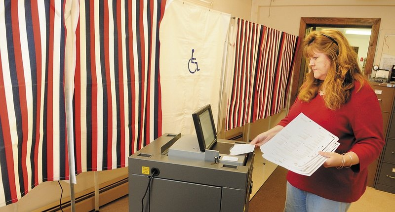 Chelsea Town Clerk Lisa Gilliam runs a test on the town's new electronic vote-counting machine, one of 65 provided to smaller Maine municipalities as a result of the 2002 Help America Vote Act.